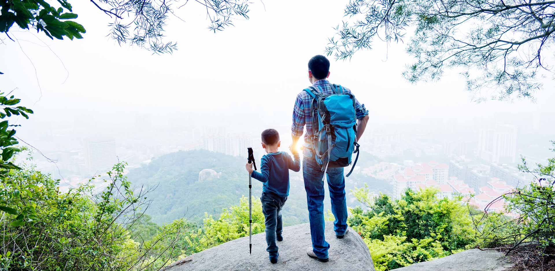 man and boy hiking